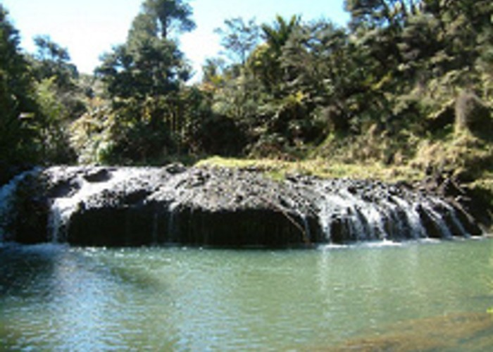 A very interesting fall over what appears to be volcanic rock, into a delightful pool, downstream