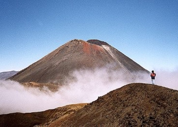 Mt. Ngauruhoe with clouds and hikers from above Red Crater on the the Tongariro Crossing