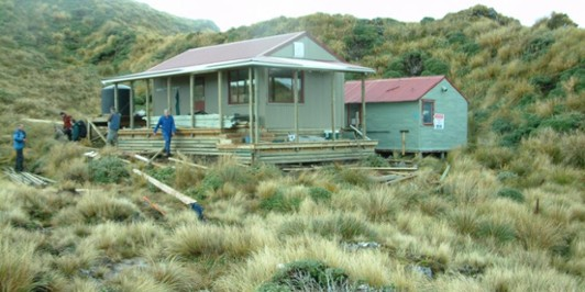 New and old Maungahuka Huts (old hut removed)