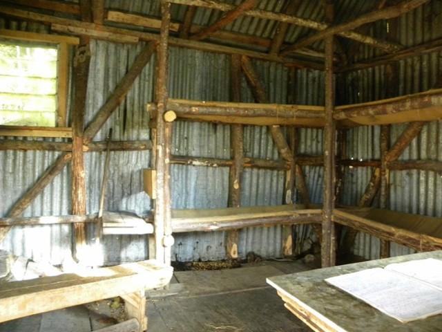 Looking inside Earnslaw Hut - Mt.Aspiring NP