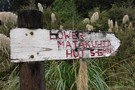Sign at Upper Matakuhia Hut