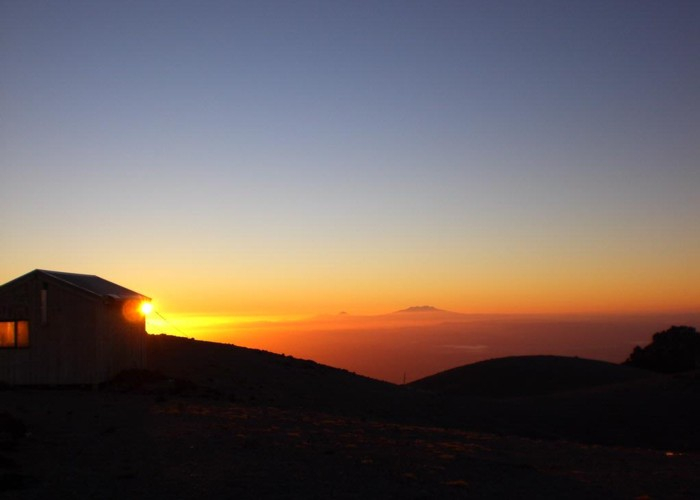 Syme hut at dawn with Mt Ruapehu background
